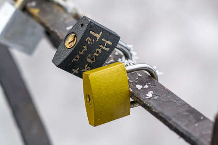 Locks on the railing of the bridge symbolizing love and loyalty Stock Photo