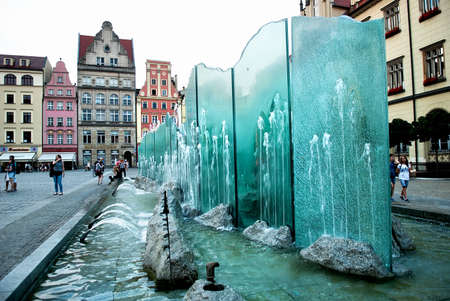 rynek: Wroclaw, Poland - July 16, 2014: Fountain on the Market Square of Wroclaw in Poland. Wroclaw is the historical capital of Silesia. Travel, vacation concept.