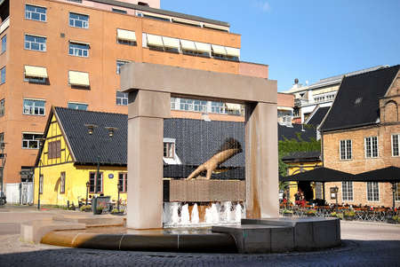 he said: Oslo, Norway - July 22, 2014: Sculpture of King Hand in Oslo, Norway. King Christian IV decided to rebuild the city after fire in 1624. He pointed to this spot and said - the new town will lie here!
