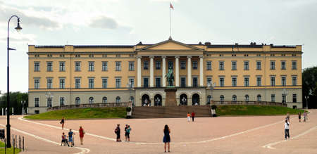 norway flag: Oslo, Norway - July 22, 2014: The Royal Palace in Oslo was built in the first half of the 19th century as the Norwegian residence of King Charles III.