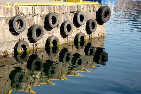 buffers: Concrete pier, with hanging tire buffers
