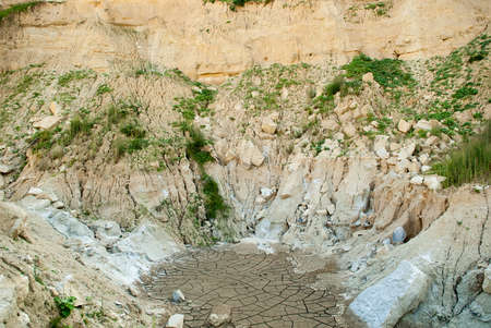 Cracked clay ground into the dry season at a forsaken quarry