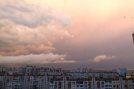 Sunset with clouds after the rain over dormitory area