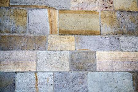Stone pavement in perspective. Stone pavement texture. Granite cobblestoned pavement background. Archivio Fotografico
