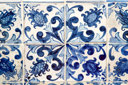 Detail of the traditional tiles from facade of old house. Decorative tiles. Floral ornament. Selective focus Banco de Imagens