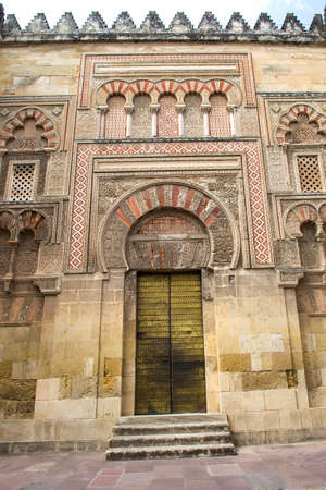 Exterior wall with great door of the Mosque Cathedral in Cordoba, Spain.