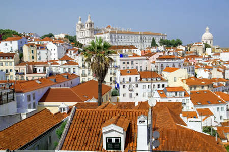View from the Miradouro Santa Luzia to the old town of Lisbon, behind the monastery church Sao Vincente de Fora, district Alfama, Lisbon, Portugal
