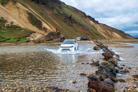 Car fording river in Landmannalaugar, Iceland
