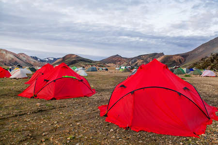 Camping tents in the mountains, tents and clothing line with volcanic mountain background, Landmannalaugar, Iceland
