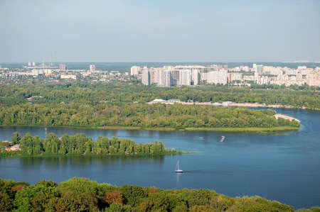 Autumn sunny hot day. Residential areas on hills in Kyiv on the left bank of the Dnieper River. Kyiv. Ukraine. 스톡 콘텐츠
