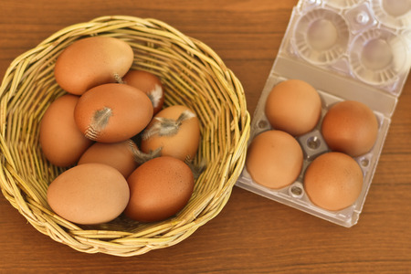 Fresh raw organic brown eggs in wicker basket prepare for packing to sell Stock Photo