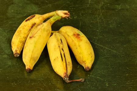 Close up bananas on old wooden texture, organic banana non toxic Stock Photo