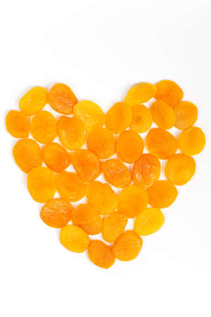 Dried apricots in shape of heart photo