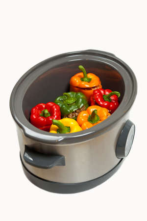 Stuffed Bell Pepper in a Slow-cooker, ready to cook Stock Photo - 19123531