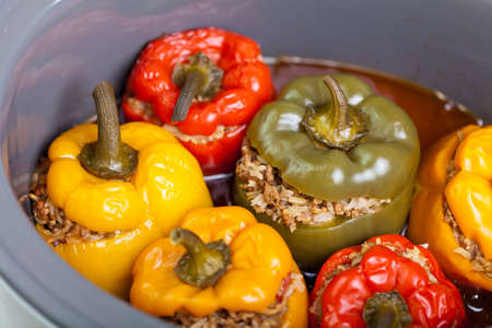 Roasted peppers stuffed with meat and rice photo