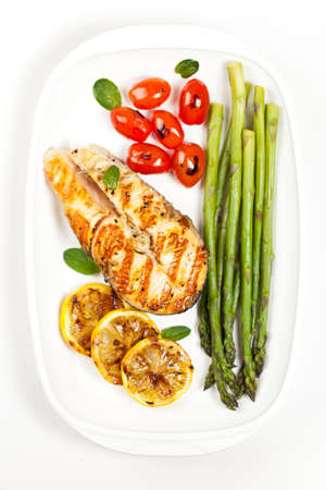 Grilled salmon steak with asparagus and cherry tomatoes Stock Photo - 19638517
