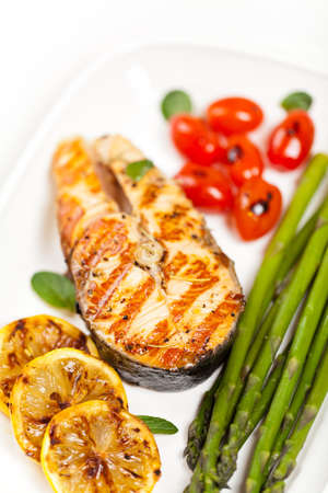Grilled salmon steak with asparagus and cherry tomatoes Stock Photo - 19638523