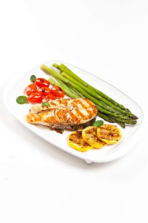 Grilled salmon steak with asparagus and cherry tomatoes Stock Photo - 19638513