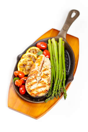Grilled salmon steak with asparagus and cherry tomatoes Stock Photo - 19638586