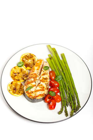 Grilled salmon steak with asparagus and cherry tomatoes Stock Photo - 19806479