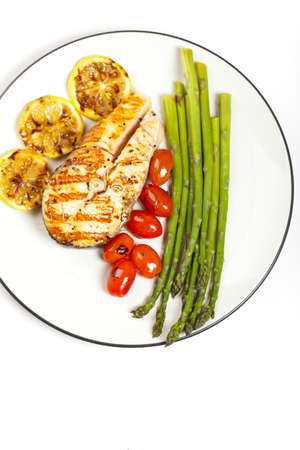 Grilled salmon steak with asparagus and cherry tomatoes Stock Photo - 19806538