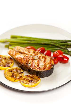 Grilled salmon steak with asparagus and cherry tomatoes Stock Photo - 19806535