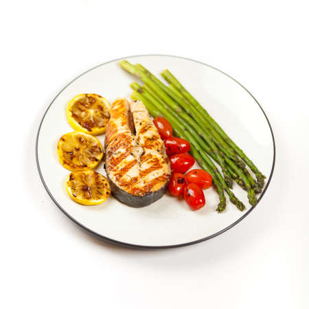 Grilled salmon steak with asparagus and cherry tomatoes Stock Photo - 19806467