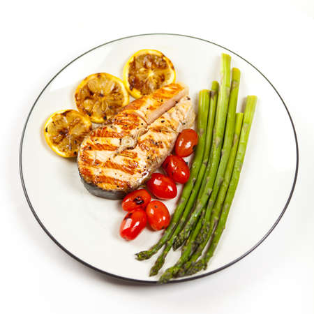 Grilled salmon steak with asparagus and cherry tomatoes Stock Photo - 19806472