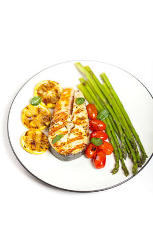 Grilled salmon steak with asparagus and cherry tomatoes Stock Photo - 19806477