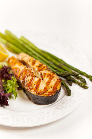 Grilled salmon steak with asparagus, lemon and salad Stock Photo - 19806521