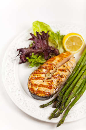 Grilled salmon steak with asparagus, lemon and salad Stock Photo - 19806542