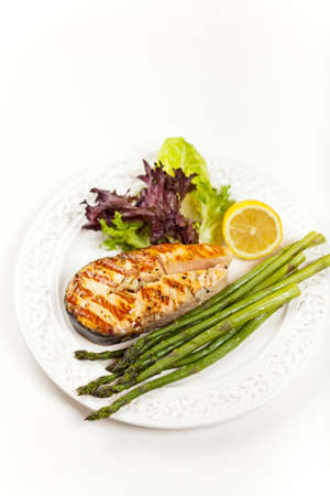 Grilled salmon steak with asparagus, lemon and salad Stock Photo - 19806518