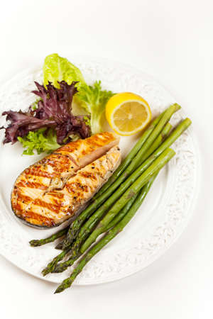 Grilled salmon steak with asparagus, lemon and salad Stock Photo - 19806534