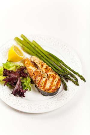 Grilled salmon steak with asparagus, lemon and salad Stock Photo - 19806512