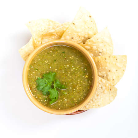 latin food: Fresh Homemade Salsa Verde with tortilla chips Stock Photo
