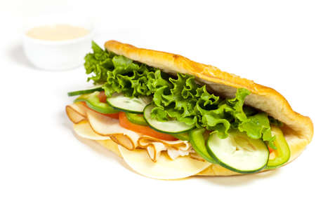 Sandwich with turkey, tomato, cucumber photo
