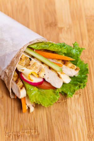 Tortilla with grilled chicken and vegetables photo