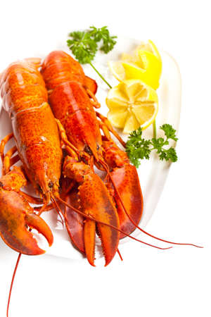 Lobster on dish with parsley and lemon slices Stock Photo