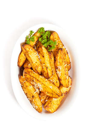 potato wedges: Baked Potato Wedges With Parmesan Stock Photo