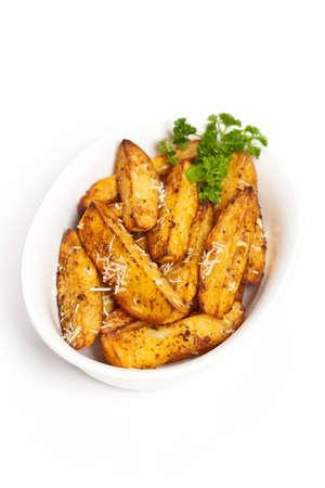 potato wedges: Baked Potato Wedges With Parmesan Stock Photo