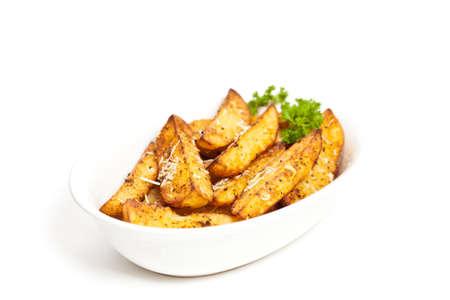 Baked Potato Wedges With Parmesan Standard-Bild