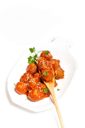 Meatballs in tomato sauce with parsley and parmesan photo