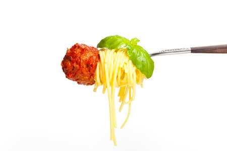 Meatball with spaghetti and basil on a fork photo