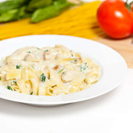 Chicken fettuccine alfredo with spinach photo