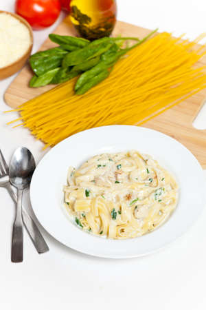 Chicken creamy alfredo sauce with white meat chicken, spinach   fettuccine pasta photo