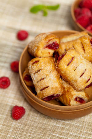 Raspberry filled pastries with sugar sprinkles photo