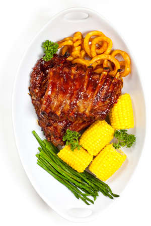 Freshly Grilled BBQ Ribs with Corn photo