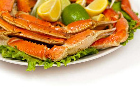 Crab legs with lemon photo
