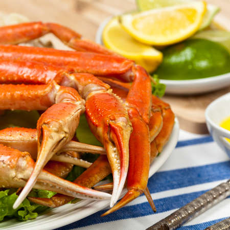 Snow Crab legs with fresh lemon slices and butter sauce