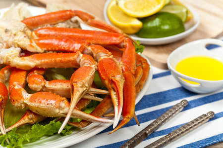 animal leg: Snow Crab legs with fresh lemon slices and butter sauce